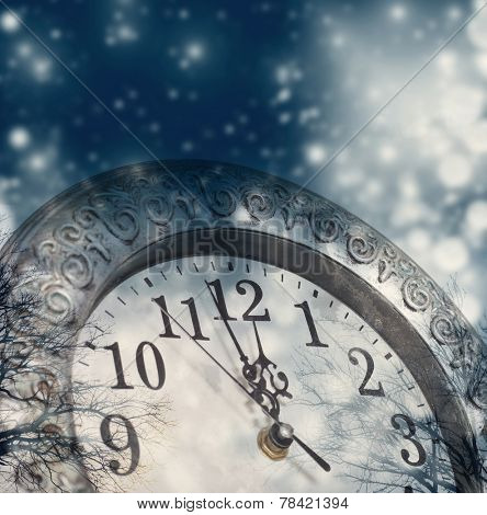 New Year's at midnight - old vintage clock and holiday lights
