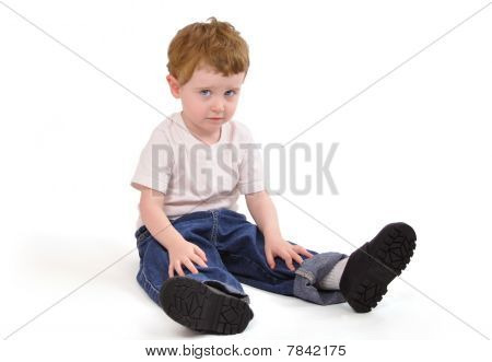 Young Upset Boy Sitting Down