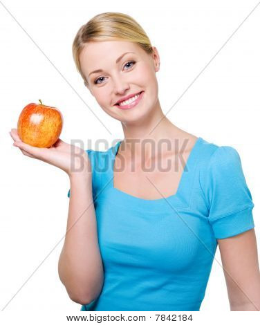 Beautiful Smiling Woman With A Red Apple