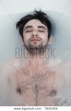 Young Man In A Bathroom With Muddy Water