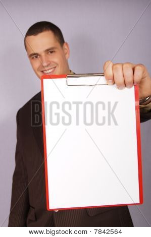 Young businessman with blank paper