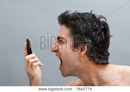Man Shouting On His Cell Phone