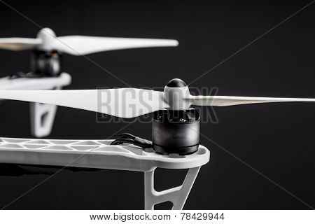 propellers of a hexacopter drone against black background