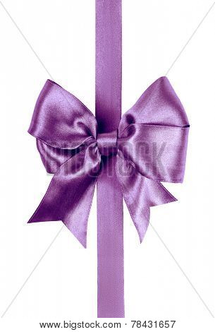 purple bow made from silk ribbon
