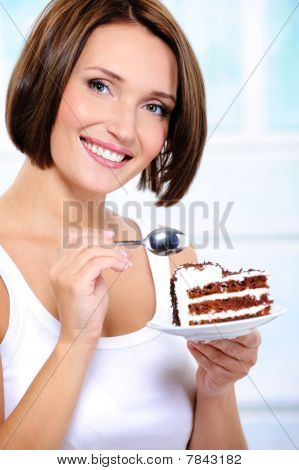 Young Woman With A Cake Slice On A Plate