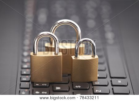 Internet security concept with padlocks on laptop keyboard