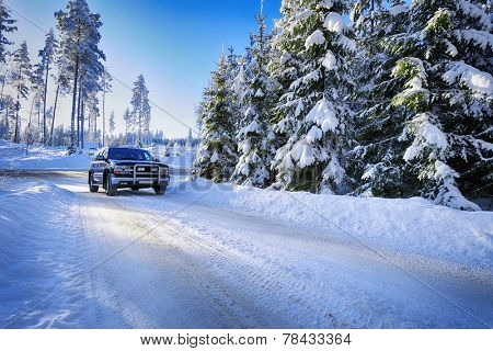 large suv, car driving in rough snowy terrain