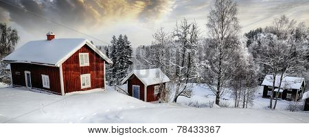 old 17th century cottages draped in a snowy winter landscape