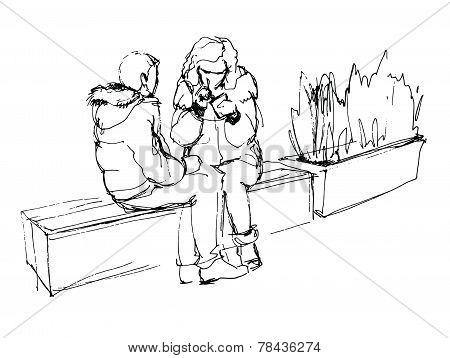 Couple Talking While Sitting On A Bench