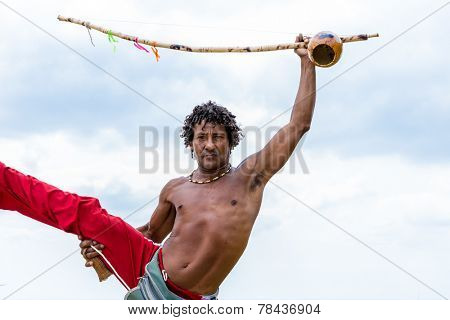 Brazilian playing Berimbau Instrument in Salvador, Bahia, Brazil.