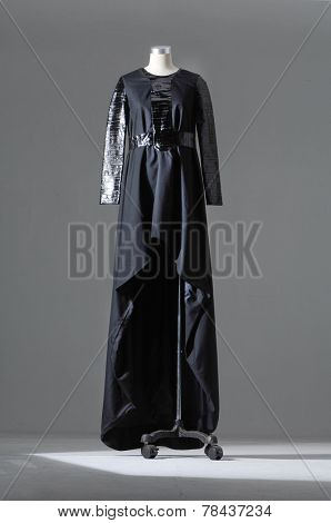evening gown on female mannequin on light background