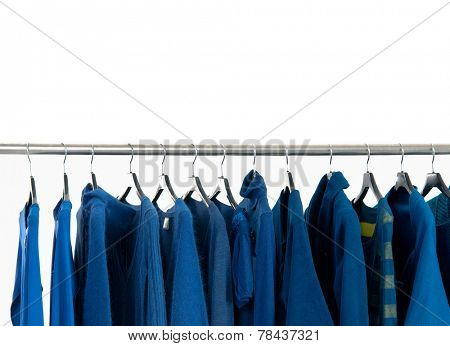 Set of female blue dress and coat isolated on hanging