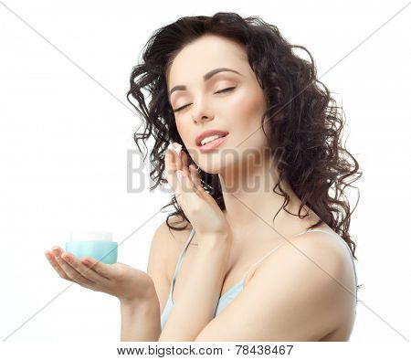 closeup portrait of attractive  caucasian  woman brunette isolated on white studio shot lips  face hair head and shoulders eyes closed applying cream