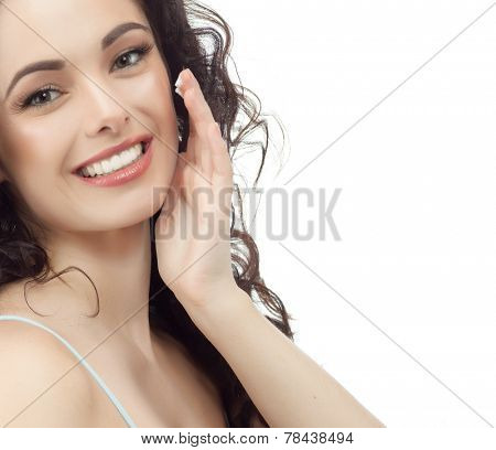 closeup portrait of attractive  caucasian smiling woman brunette isolated on white studio shot lips toothy smile face hair head and shoulders looking at camera tooth applying cream