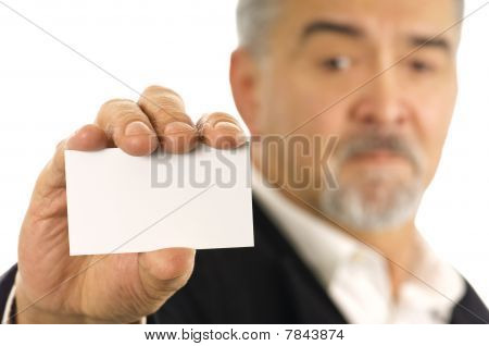 Closeup Of Mature Businessman Holding A Blank Business Card