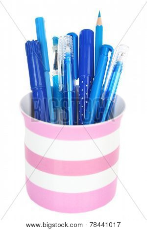 Blue pens, pencils and markers in striped plastic cup isolated on white background