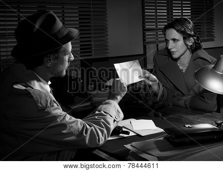 Woman Handing Over An Envelope To A Detective