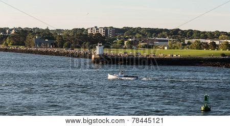 Fishing Boat Past Maine Lighthouse