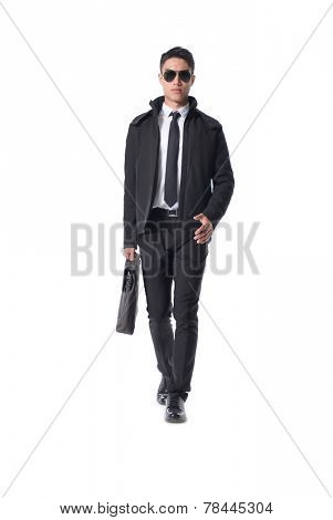 handsome young business man walking carrying a suitcase �¢�?�?full body