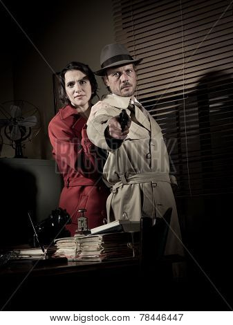 Detective Protecting A Young Woman Pointing A Gun