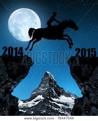 The rider on the horse jumping into the New Year 2015. In the background Matterhorn.