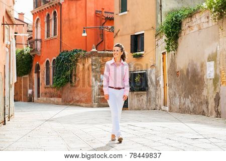 Young Woman Walking In Venice, Italy