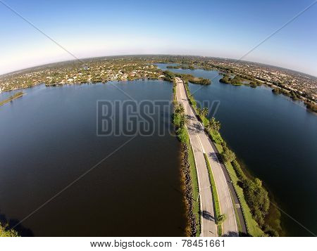 Road Crossing Lakes Aerial View
