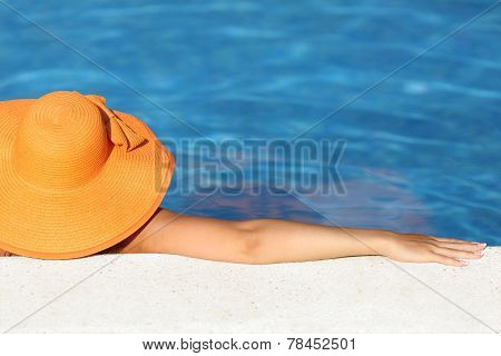 Woman With Picture Hat Bathing Relaxed In A Pool Enjoying Vacations
