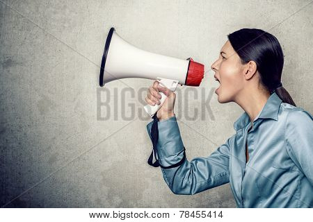 Young Woman Shouting With Megaphone