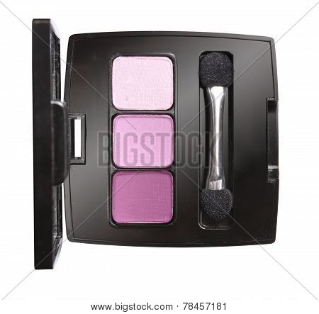 Eye shadows with eye shadow brush on white