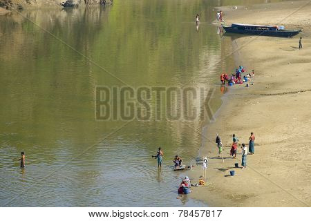 People wash clothes at the river bank in Bandarban, Bangladesh.