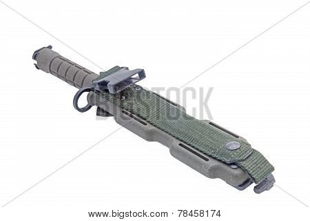 Army green of modern military knife in pocket isolated white.