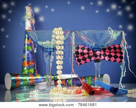 Happy New Year Party Scene With Male And Female Cocktail Martini Glasses With String Of Pearls And B