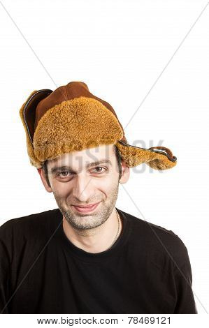 Young Bearded Man In The Earflaps Hat