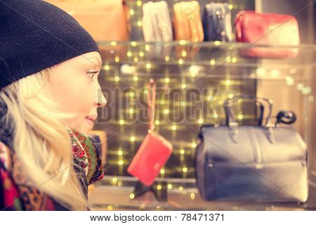 Woman Looks At Window Shop