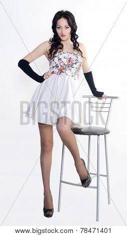 Female model in short white skirt