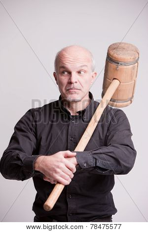 Suspect Man With A Wooden Big Hammer