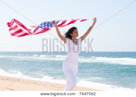 young active woman holding flag