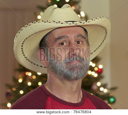 A Bearded Cowboy By A Christmas Tree