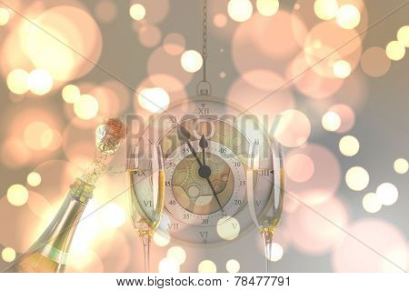 Hanging pocketwatch against sparkling wine