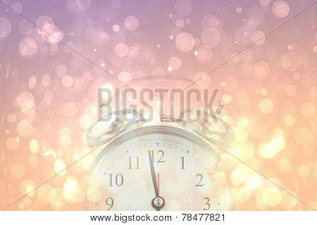 Alarm clock against pink abstract light spot design