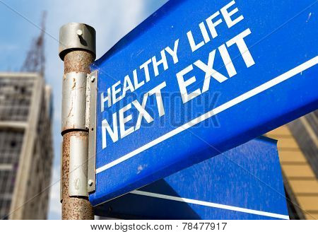 Healthy Life Next Exit blue road sign