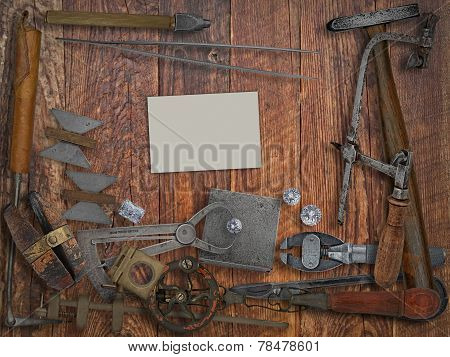 Vintage Jeweler Tools,diamonds,business Card Over Wooden Wall