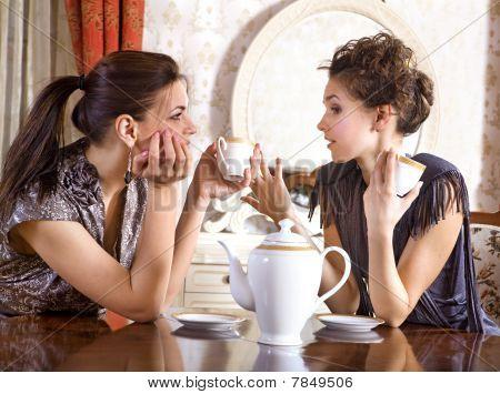 Two Pretty Girl-friends Drink Tea