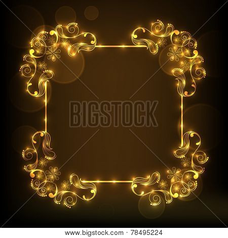 Beautiful shiny floral pattern decorated golden frame in square shape on brown background.