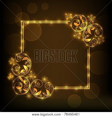 Glossy frame decorated by beautiful golden floral design on shiny brown background.