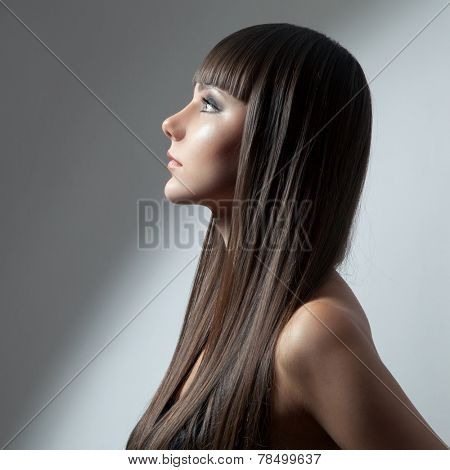 Hair. Beautiful Brunette Girl. Healthy Long Hair. Beauty Model Woman. Hairstyle
