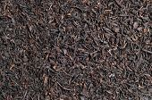 stock photo of iranian  - Black Iranian large leaf tea background with copy space - JPG
