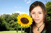 girl outdoors with a sunflower poster