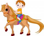 stock photo of little boy  - Cute little Boy riding on a horse - JPG